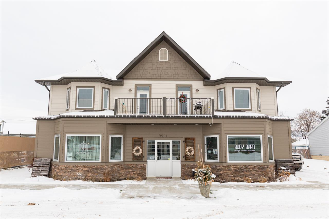 Investment Alert!! This fully Tenanted Building was built in 2014 on a 7412.7 sq ft Lot.  This Building has 2 Retail Bays on the main floor.  Both have separate front and rear entrances. They are 1233 sq ft each.  The second floor has 2 Residential Suites both have entrances from the rear.  Each unit has 2 bedrooms, large bathroom, Kitchen, Living Room and Laundry Room.  Both Residential units have Front and Rear Balcony's and are 1045 sq ft.  Each Tenant has 2 parking Spaces in the fully paved lot.  All 4 Bays have separate utilities and the potential to be Condominiumized.  All Measurements to be confirmed by purchaser.  Do not approach Tenants or Staff.  Tremendous upside in the town of Morinville.