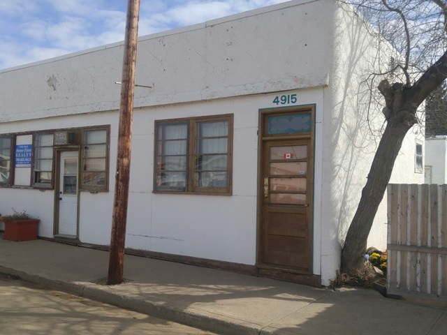 Wonderful opportunity to open your own business and live on site in the Village of Holden, approximately 50 minutes East of Edmonton. Commercial/residential split. Total of 2151 sqft with office/retail adjacent to Main Street and a 2 bedroom residence with ayrd and 24x14 garage in the back. Lot is 50ft x 130ft. Former home to a hair salon, laundromat and offices. Original structure built in 1942 (with crawl space). Residence added in 1964 (with basement). Welcome Home!