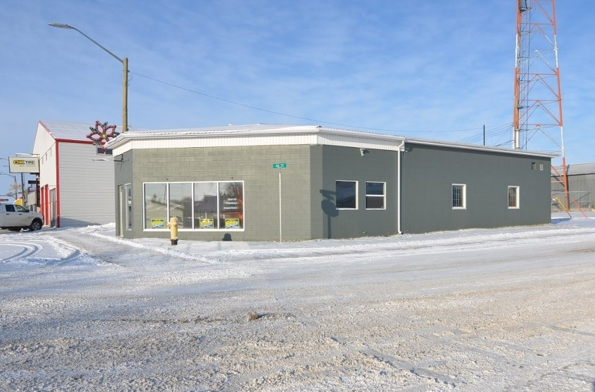Excellent/Quality property for private mechanic shop or retail shop - Good Commercial / Industrial location near busy area of Barrhead. Corner lot with great visibility for business and customers. Attractive cement block building in good condition. Extra room for parking or display of product. Land Area 3,798 sqft. Building Area 2049 sqft. Present Work Shop Area is 30' x 40' with 12' x 12' O/H Door. Balance is Office, Parts Storage, 2 unit Washroom. 2 O/H Furnaces.