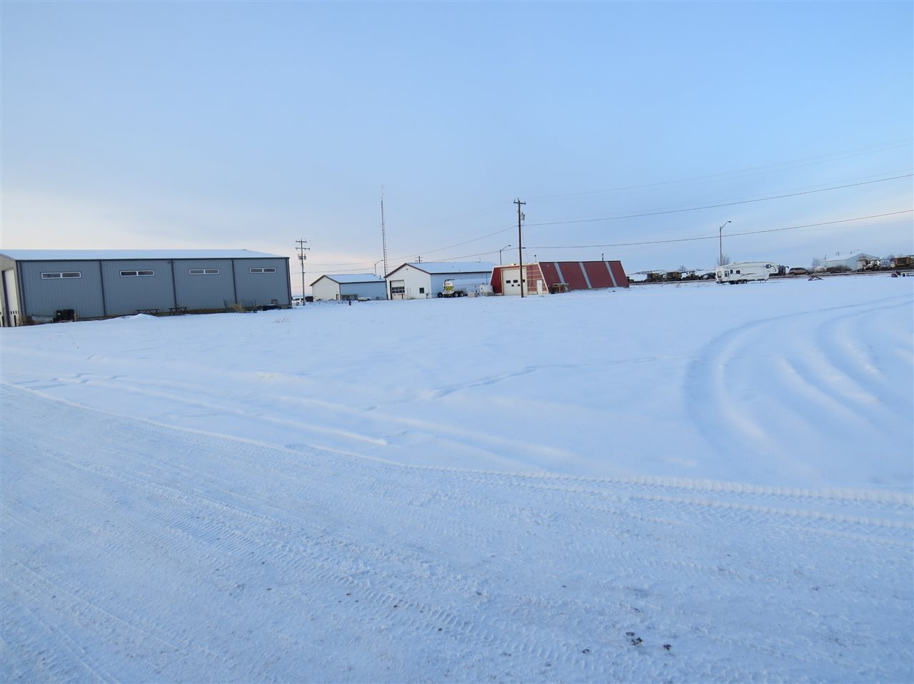 3 Large Commercial Lots, .8 acres Lougheed! Build a shop or just terrific secure Storage for pipe, equipment parking or whatever you like in this nice safe business area of Lougheed, close to Hardisty Oil Storage Terminal and oilfields in East Central Alberta. Level and ready to build on also great location just off Hwy 13 and easy access with front and back lane into property. Priced right, ready to sell all 3 lots $45,000.