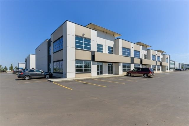Great Lease Space In Westana Phase 111 close to Sherwood Dodge and The Road King .  This Quality Constructed Prime bay features over 3439 SQ Ft of raw space.  Consists of a 1465 Sq ft Warehouse with an 12' x 14' Overheard Door, Radiant heater, 987 Sq ft Retail / Office Area and a 987 Sq ft Mezzanine area .  Owner willing to break up the space and built to suite Tenant .  Located in a high traffic Condo complex with lots of parking and the last bay with neighbors including a Appliance store, Blind Store and a Home Improvement center .