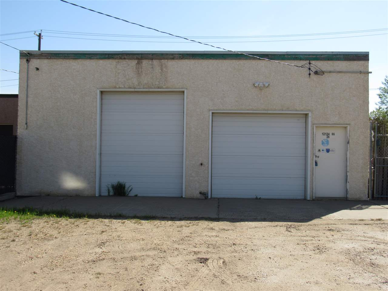 """COMMERCIAL ZONE  """"CB1"""" .  Street front  on 66 Street  location and just 1 minute to Yellowhead Freeway.  Free Standing Building approx. 2640 square ft..   Property has  Parking at front on 66 street and additional parking at the  rear.   2 Doors 10ft high and 9 ft high . ceiling height is 12 ft.  Ample power, 2 bathrooms , lunch room 4 offices, air condition..   GROSS LEASE  Rent is $2,900.00 per month.  Tenant pays utilities and all tenant license and business tax etc.   Past Tenant was an Air-condition and plumbing Company so is basically clean .  Also good for Auto or Service business , Shop,  Clubs, Convenience Store , Liquor , , etc...   The Shop area is 45 ft long could be made  bigger by removing some of the office / retail area in front area.  Lot is 33x 126 ft  Building is 80 ft long- . The Front of building will be painted , in good weather.   Additional fenced yard  33x126 ft. could be rented also ( price to be negotiated)  Also FOR SALE $649,900..00 listing #e4099817"""