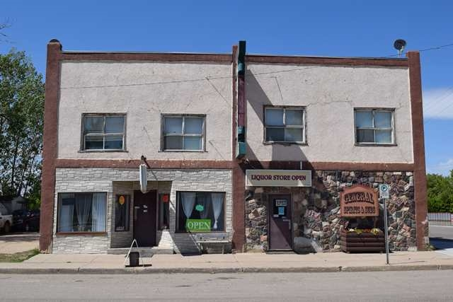 Investors, Have a good look at this 5495sq.ft. two storey Hotel located in a busy oil and gas area of Alberta. Upstairs features 14 Rooms,  3 bathrooms, laundry room and shared kitchen area. Main floor has two separate entrances to separate businesses. The first business is a 1312 sq.ft Liquor store with walk-in cooler and the second business is a 1202 sq.ft Restaurant with range, grill fryer, walk in cooler prep area. Both which are currently being leased. The property is a double lot which offers the opportunity to move a Mobile home on the vacant portion of the property. Property will be sold WHERE-AS, AS-IS, some financial information can be provided with the sellers discretion. GST will apply to this property.