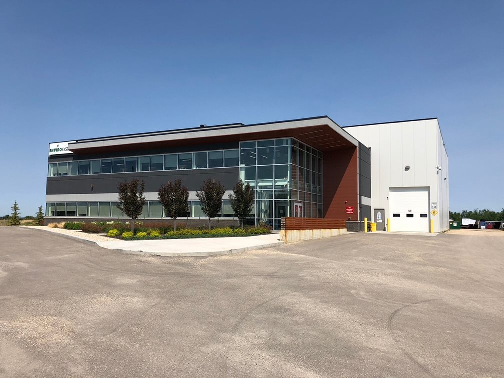 """State of the art office/warehouse manufacturing facility on 3.66 acres +/- available for sublease. If required, there is a possibility for additional land adjacent to the property. With a high ratio of quality custom designed office build out over two floors (approximately 30%) and fully furnished offices, this sublease is ready for you! Other features include a 600 volt electrical service, craneways, multiple oversized loading doors, advanced makeup air systems, and a wide clean span warehouse. This property also offers LED shop lighting, 7"""" fibre reinforced concrete floors and 30' clear ceiling height (26' under hook). With a long term lease in place there are a variety of sublease terms available through 2027."""