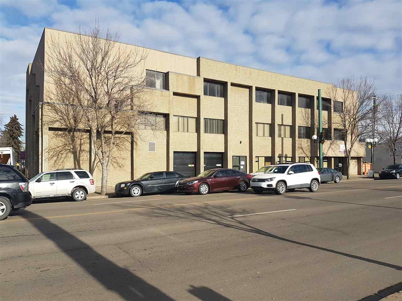 Over 15000 sq. ft. of retail and office space in this 3 storey, stand alone commercial building strategically situated in north central Edmonton near LRT line. Main floor has a street front retail bay with overhead doors for large vehicle parking/unloading. Three levels - all with office space.   Main floor can be office and/or retail.  This price includes a large parking lot on the side of the building. Main floor is concrete block and 2n3 and 3rd floors are post and beam construction.