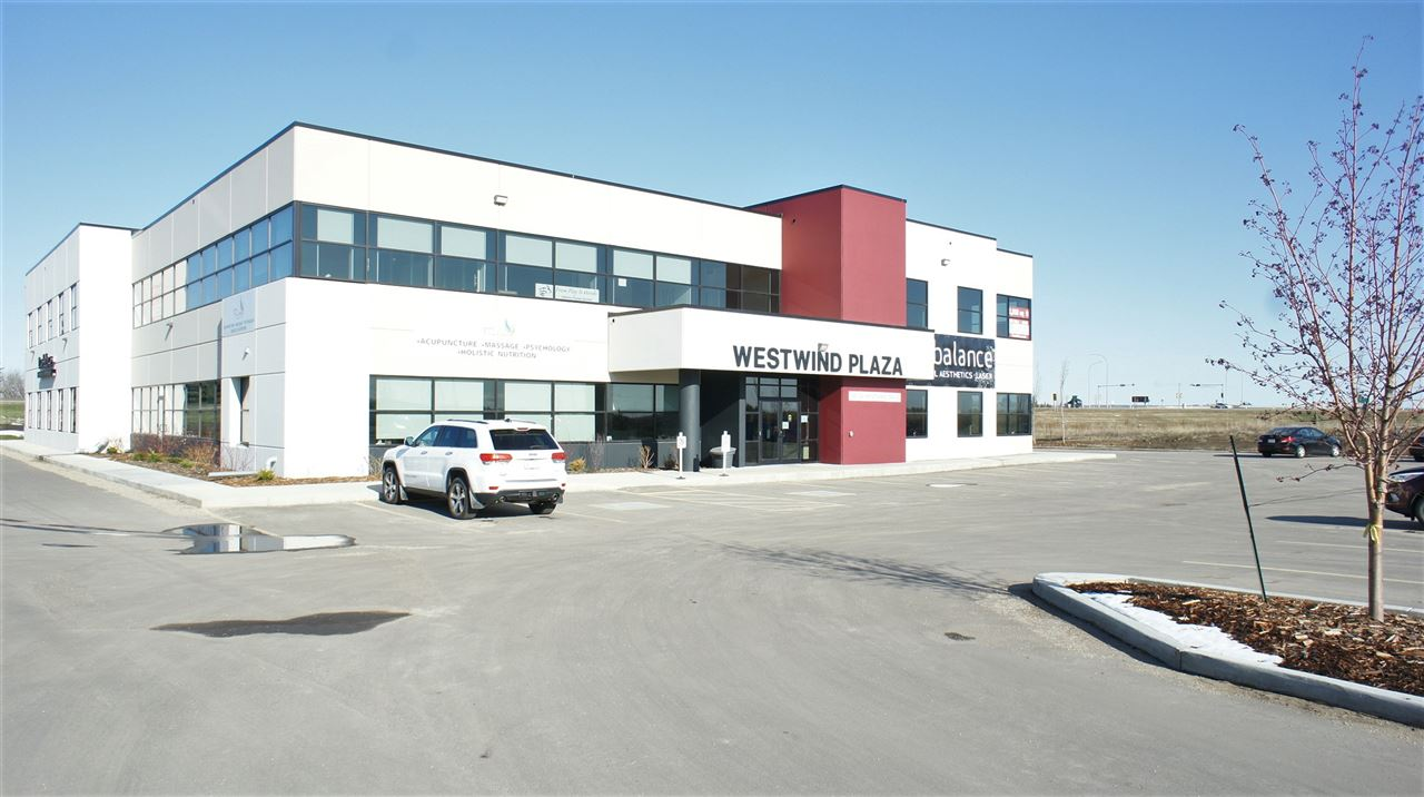 LEASE RATES REDUCED!! FOR LEASE/FOR SALE.  Westwind Plaza is a New precast concrete professional office building fronting Century Road, a major access point to Spruce Grove off of the Yellowhead Hi-way and part of the large Westwind Centre development area. This second floor office unit offers 2229 sf with and the potential to combine and additional 2058 sf in an adjacent end cap unit with wrap around windows.  12' ceiling heights, elevators and men's and ladies common washrooms on second floor in place.  Multiple options in size configurations for individual units ranging from 1577 sf to 2400 sf in the project.  A great mix of medical, wellness, fitness, professional office and child services users already in place in what will be a major commercial business development area.  Plans for the area include a major rec/entertainment facility, transit station, hotels and significant retail and office component some which are already well underway and occupied by major tenants. Ask about Lease to Own program.