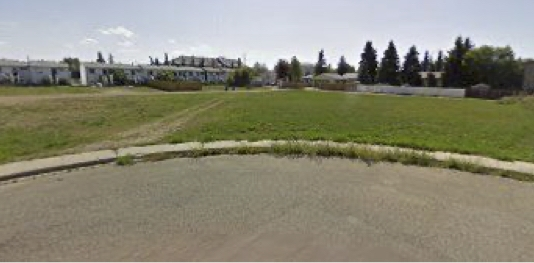 Excellent value given the possibilities on this R5 lot in central Wetaskiwin. Vacant serviced 2823 m2 (30,389 sq ft) lot R5 zoning that includes the permitted uses: Single Dwelling Building, Duplex Housing,Triplex Housing, Fourplex Housing, Accessory Building, etc. Please note some photos are renderings of a planned development for 4 buildings of 4plex style rental units for a total of 16 units. Plans available but permits and any required variances are the responsibility of the buyer.