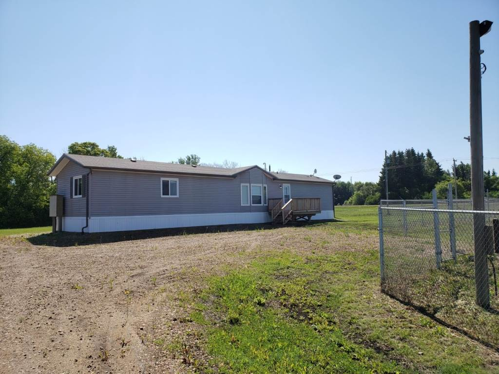 AWESOME COMMERCIAL PROPERTY WITH HIGHWAY FRONTAGE ALONG HWY 55/63 IN GRASSLAND! Get 3 Prime Acres of Real Estate! 1 acre is fully fenced, gravelled, surveillance (approx. 10 cameras) and yard lighting! 2015 mobile/office has approximately 1216 sq ft of space and includes 3 bedrooms and 2 bathrooms. It can be used as the perfect office space or live/work business space. Home/office has new well, natural gas, and 2800gal septic holding tank. If you are looking for a storage facility, trucking head quarters, or just a good sized property with highway frontage this is the property for you! half way between Edmonton and Fort McMurray it's the perfect half way point!