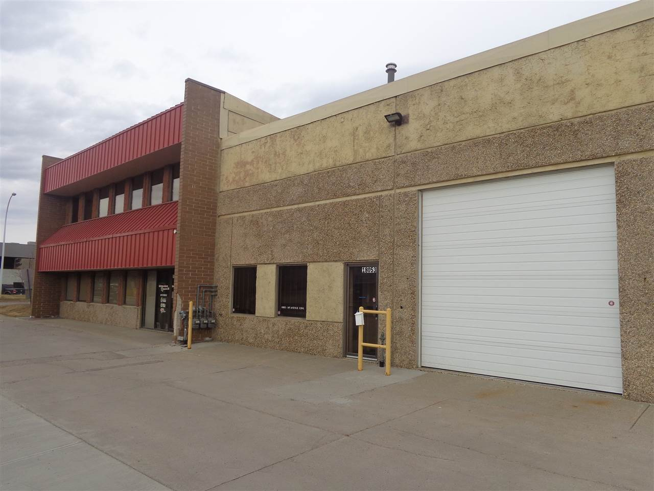 2318  Square Feet of usable space (1492 Main + 825 Upper) in Wilson Industrial. This space is perfect for office, retail or industrial use. This unit has 3 phase power with an upgraded panel. Two bathrooms on the main level. 12 foot Garage Bay door. 4 stalls come with this space as well.