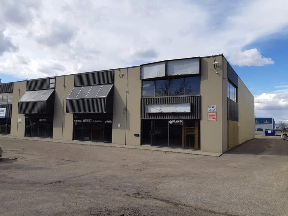 "This is a great opportunity for several different types of businesses.There are 4 separately titled 2040 sq. ft. bays  in a row that can be demised in several ways. The building fronts directly onto 107 ave and there is a lot of drive by traffic. Currently units 16, 17 & 18 have a built out show room (partially gutted) and about 2080 sq. ft. of mezzanine with offices and kitchen area also partially gutted. There are 4 14 foot doors, 20 foot ceilings, 3 phase power and a newer tar and gravel roof. The owner says bring ""OFFERS"". Show and sell with confidence."