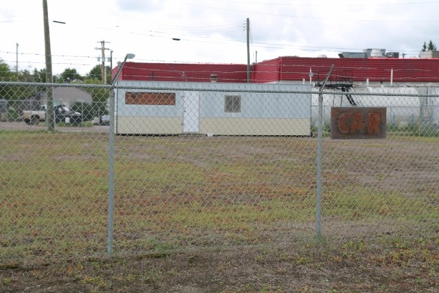 Large Commercial Lot. The property has 103 feet of frontage with a total area of .29 acres. It is fenced with a chain link security fence. The lots were previously used for car sales and there is an office with all utilities included. This property has excellant exposure to Highway 41 and would make an excellant location for any highway service business.