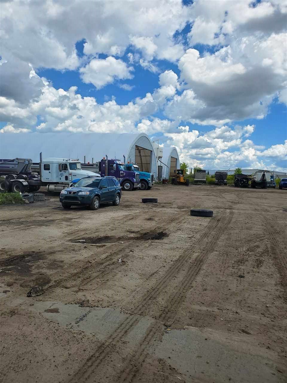 FENCED AND GATED CLOSE TO 5 ACRES OF INDUSTRIAL USE LAND WITH WATER AND ELECTRICAL SERVICES FROM CITY OF EDMONTON .Rectangular parcel with 4000+ SQ FT BUILDING AND QUONSETS.READY TO START YOUR OPERATIONS.CLOSE TO ALL MAJOR ROADS.