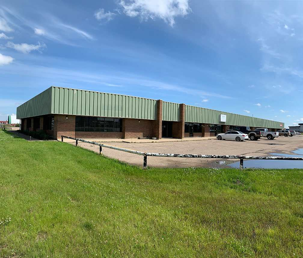 4,000 sq.ft.± fully developed office space available for lease ? Current configuration consists of 6 offices, reception, boardroom, bullpen, lunchroom and storage areas ? Corner unit with lots of natural light ? Double row parking on site Loading door could be potentially be added ? Easy access to Airport Road, Highway 2, and Highway 625