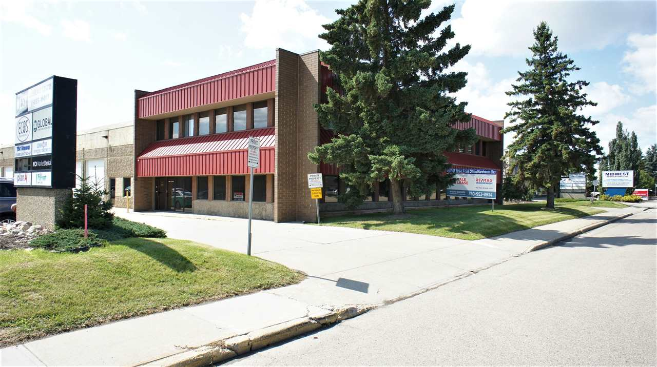FOR SALE OR LEASE.  Street front office/warehouse unit fronting 107 Avenue offering 3107 sf of space in two combined bays. New flooring and fresh paint. Well designed perimeter offices in main office area (Unit 1) featuring 5 perimeter offices, 4 with exterior windows for natural light but all offer glass demising walls, a staff/lunchroom, storage and M/W washrooms. The office development continues into Unit 2 where a large common work area, board room and access to the approximately 800 sf of full height warehouse with 12' grade loading and a separate man entrance to that space.Storage mezzanine is created above the common work area and board room. 9 assigned parking stalls.