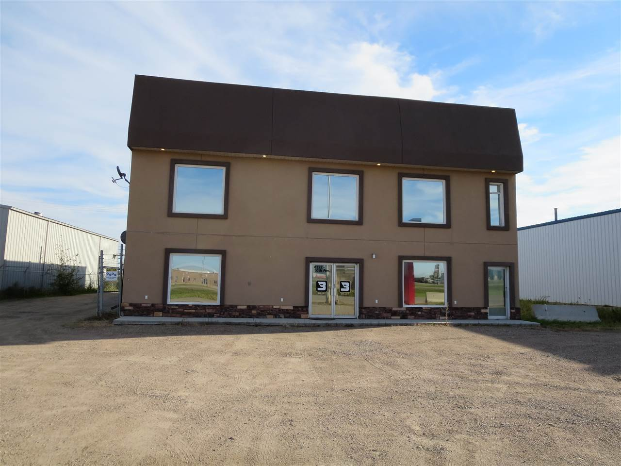 Prime location, prime opportunity! This 6000sq ft shop is located on a double lot totaling nearly 3/4 of an acre, on the west end of Bonnyville has great exposure to Hwy 28 incoming and outgoing traffic. Main level offers a welcoming front reception area, 3 office spaces and a kitchenette, while upstairs has a board room, 4 more office spaces, kitchen, and a 3pc bathroom. The well-situated 50'x70' shop space features radiant heat, tin lined interior, concrete floors, two 18' high x 14' wide overhead doors, floor drains, and a mezzanine for extra storage. Huge gravel yard is fully fenced and offers drive through access. Take advantage!