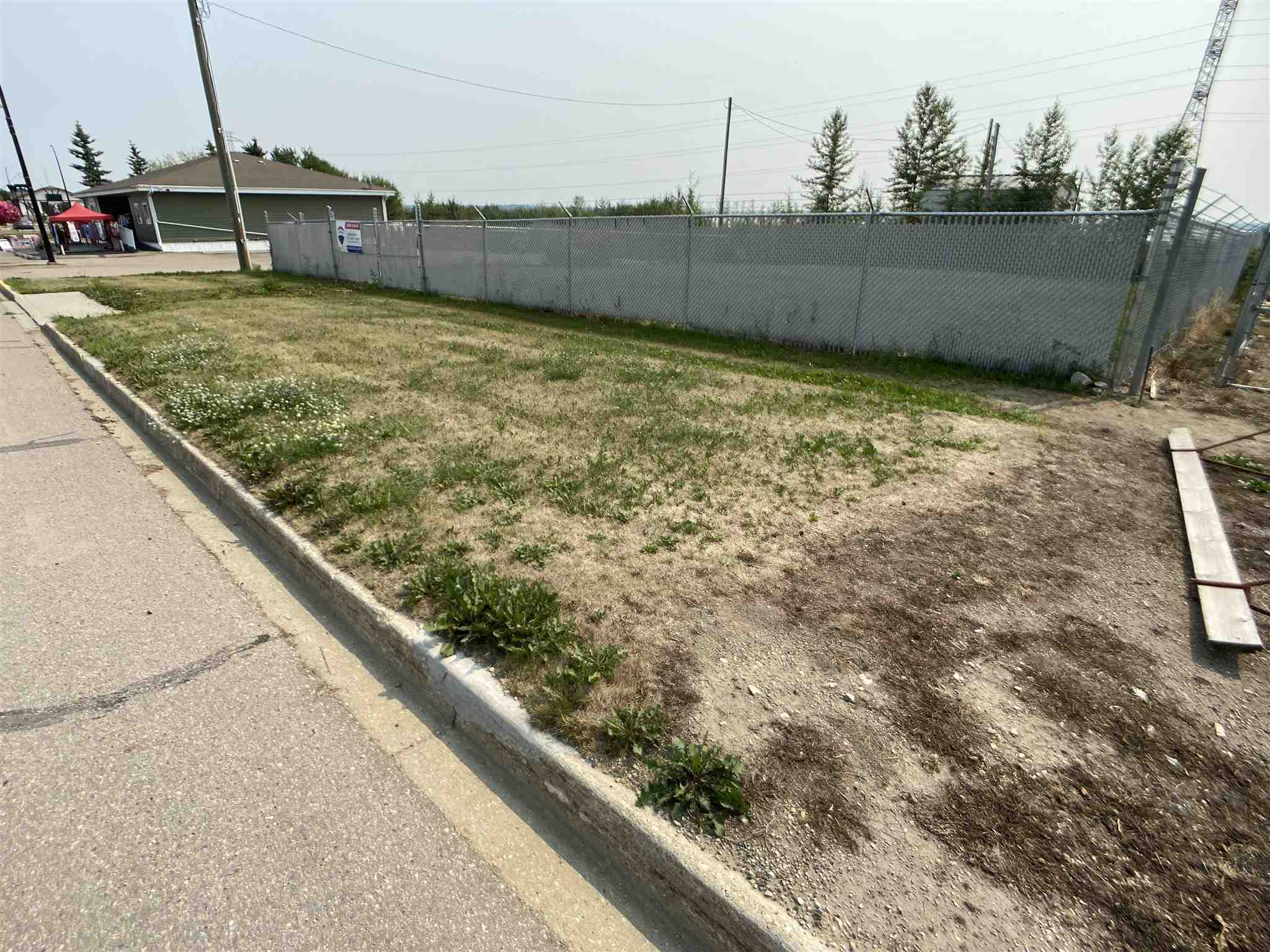 Great Commercial Location!!!  Located on the main street of the Village of Wabamun.  This spot is ready for development.  Roughly 100' x 100', the land is currently fenced.  Many options for you to build or buy & hold.