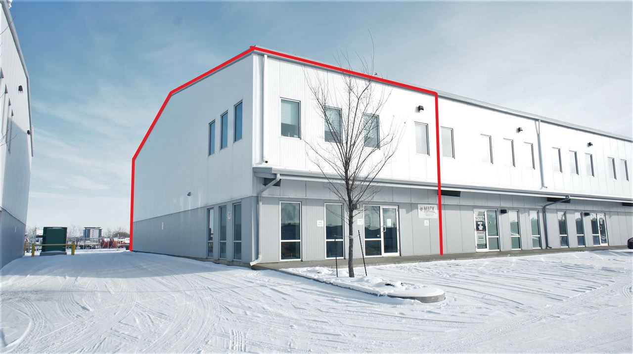 End Cap Office/Warehouse unit offering 3180 SF with 1560 SF of developed office and 1620 SF of open warehouse.  Main floor office contains a reception and waiting area, private office, large open work area, kitchenette and handicapped washroom.  Mezzanine office with lots of natural light features two additional 10'x14' offices and a 14'x24' open work area that would serve well as a board room or collaboration room.  Warehouse ceilings are pitched and heights are 22' and 33' at peak.  Dual stage sump pump, 12'x14' grade loading doors. Large marshalling and loading areas.  3 Phase power and HVAC.  Fenced yard space is available to lease from the developer at additional cost. Condo fees are $338.02