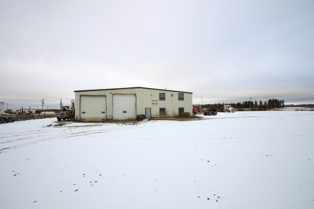 PERFECT FOR AN INVESTOR OR COMPANY LOOKING FOR SHOP AND YARD! HALFWAY BETWEEN FORT MCMURRAY AND EDMONTON! This 1.58 acre parcel is conveniently located in the community of Grassland right along HWY 63 with GOOD HIGHWAY EXPOSURE! The yard is perfect for large trucks, storage or parking. The shop itself offers over 7000 sqft with 3 overhead doors and office space. The building has a partial second story that was used as living quarters. This property is well suited for the multiple industries. The property is currently rented.