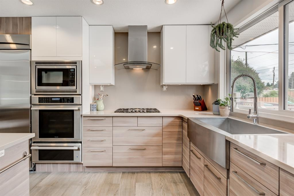 Stunningly renovated bungalow across the street from the park!  Featuring 1150+  SqFt of beautifully refined, open and functional living space, 3+1 bedrooms and 2.5 bathrooms. No detail has been missed here from the amazing SS Thermador appliance package to the heated floors in the kitchen & at the back door, spa-inspired bathrooms, under-stair wine cellar, massive skylight, smart storage solutions and oversize, heated garage. The centrally located kitchen is perfectly appointed with wall oven + integrated microwave + warming drawer, gas cook top, stainless farmhouse sink, quartz counters and an abundance of work and storage space while opening onto a nice size dining nook. The living room easily accommodates your furnishings and is wired for surround sound with wall mount TV (included) and river-rock gas fireplace. The Master suite is equipped with 2-piece ensuite and access the deck/back yard while two other well proportioned bedrooms share the adjacent 4-piece bathroom. Downstairs find a huge rec room, also wired for sound, 4th bedroom and gorgeous 3-piece bathroom with sauna. A West facing backyard provides a ton of privacy with 2-tier deck, raised garden beds and two storage shed. New Shingles on house and garage 4 years ago. Bonavista Downs is a popular family neighbourhood in Southeast Calgary. Residents enjoy wider streets and larger lots and beautifully maintained homes along with numerous parks and easy access to Anderson Road, Bow Bottom Trail and Acadia Drive.