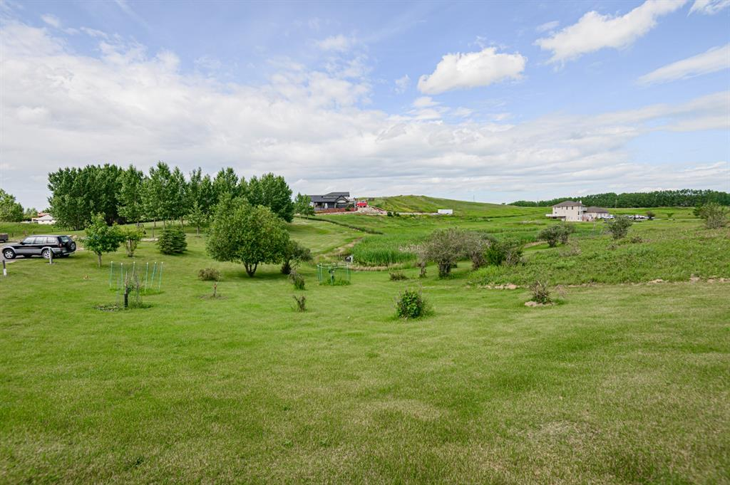 BEAUTIFUL 2.4 ACRE LOT LOCATED IN THE HEART OF POPULAR RAINBOW HEIGHTS IN BALZAC. BREATH TAKING CITY AND MOUNTAIN VIEWS. COME BUILD YOUR DREAM HOME ON THIS GORGEOUS TREED SLOPING LOT, TASTEFULLY DESIGNED AND MAINCURED FOR YOUR ENJOYMENT. BRING YOUR OWN BUILDER, CUSTOM DESIGN TO YOUR NEEDS. CALL TO VIEW TODAY. THIS ONE WON'T LAST.