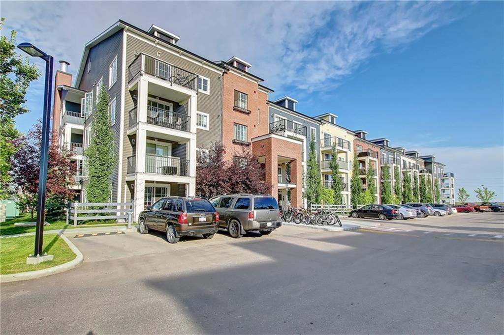 Great Value!! 2 BED 2 BATH & 2 TITLED PARKING STALLS + like new condition...Excellent floorplan with the bedrooms separated by the main living space. Master bedroom has a walk through closet, full ensuite, and extra cabinetry, 2nd bedroom has a cheater door to the main bath. Spacious living area with fabulous upgrades including granite counters throughout, additional cabinetry, water/ice maker refrigerator, vinyl plank flooring, and full height tiled backsplash. Titled underground parking stall + storage locker + outdoor titled stall, quick access to public transportation, Deerfoot, Stoney, shopping, and restaurants. Huge park across the street and connects to the city pathway system. Perfect home for a 1st time buyer/ investor/ downsizer. Call today to arrange your showing!