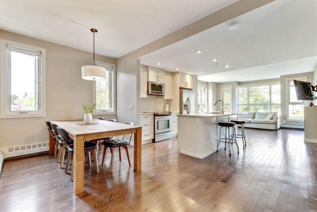 This spacious home situated in the CONCRETE  ?Tweed? building is located on a tree-lined street in the heart of Cliff Bungalow/Mission, walking distance to shops, restaurants, urban parks and paths, plus minutes to downtown. This sure, to impress BRIGHT OPEN CONCEPT SOUTH WEST CORNER unit showcases pride in ownership! Enjoy 9? paint finish ceilings, gleaming hardwood, a central gourmet kitchen with updated white cabinets, granite counters, tile backsplash and SS appliances.  The kitchen opens up to a massive living room with floor to ceiling windows, featuring a contemporary gas fireplace, with access to the balcony ( BBQ gas line included)  and a large dining area and designated office space. Making this space ideal for entertaining and hosting gatherings. This, two-bedroom home, with large  Master has a  spa like ensuite,  dual sinks, and large tiled shower.  The secondary bedroom has its own individual walk through closets with access to a seperate bathroom. Convenient in suite laundry and titled parking included.  This home is a must see... check out the virtual tour or book your showing today!