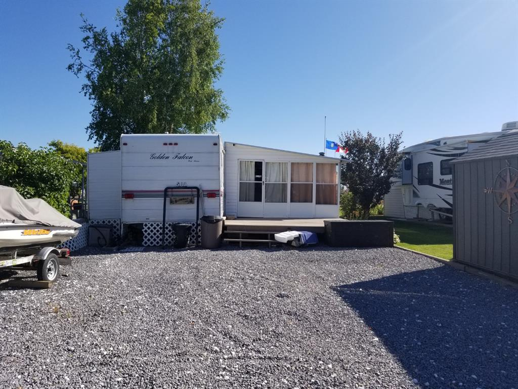 Excellent location right across from the new Marina Park playground.  The 38 foot, 2000 Golden Falcon Cottager trailer comes with attached sunroom with a wood burning stove.  This air-conditioned unit with 2 slides and a lock-off second bedroom comes fully furnished with queen bed, 2 hide-a-bed couches and kitchen table with 4 chairs.  There are 2 decks, a new shed and a large parking area for all the toys.