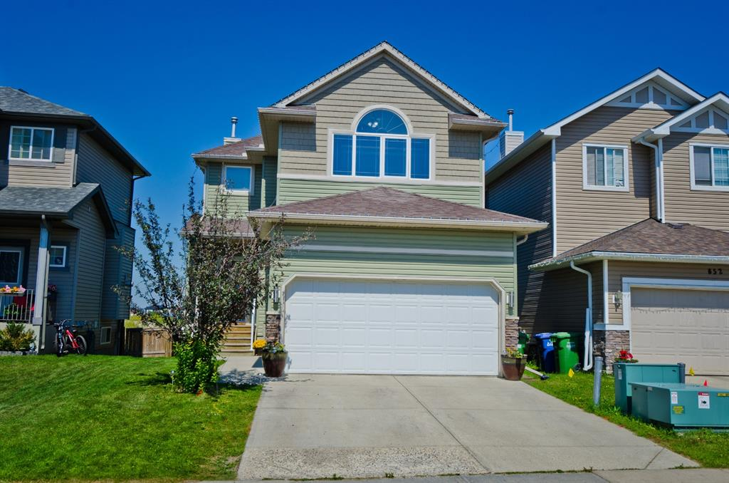 Enjoy the feeling of living in a brand-new home but in an established neighborhood on a huge lot that backs onto a natural canal! This is what you will find in this modern, clean updated two story walk out.   The kitchen has been redone with ceiling height cabinets and multiple pantry's that provide ample storage, quartz counter tops shine and all new stainless-steel appliances complete the kitchen. The main floor family room features a wall to wall entertainment center, big window and while you can?t see it a gas fireplace tucked behind the wall unit. The main floor is complete with 3 large closets, fully renovated powder room and laundry room with new washer and dryer.  Enjoy new luxury vinyl floor, baseboards and moldings throughout the main.  Upstairs you will find new flooring, paint and moldings. The bonus room is huge with vaulted ceilings and a large picture window bringing natural light in all day. The master bedroom is large, plenty of room for king size bed and furniture. Walk through his and hers closets one walk in both with built in organizers to keep everything tidy. Master bath features a deep soaker tub and walk in shower with bench. The remaining two bedrooms are large both outfitted with closet organizers and bright windows.   The back yard is huge, a rare find in a newer development and backing onto a natural canal you get added privacy of no rear neighbor! The walk out basement is well laid out and waiting for your development plans (roughed-in for future bath).  In 2014 all new siding, 30 year roof and new triple panels windows were installed keeping you cool in the summer, draft out in the winter and excellent sound barrier. Luxstone is centrally located with easy access Nose Creek Park, walking paths, QE2 highway, all amenities and levels of school, check the virtual tour.