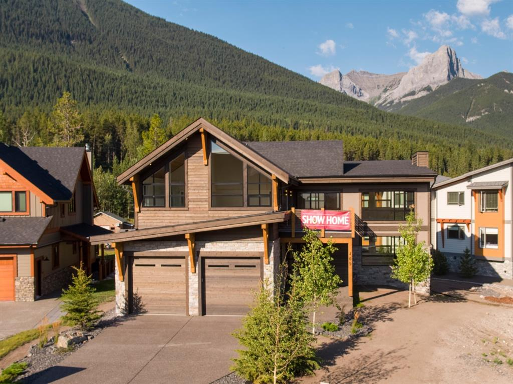 New mountain modern home in Three Sisters Phase 3. Upper level living with two large decks and spectacular views. Two large living areas. Open stairwell and triple garage. Russell and Russell contemporary design. The lower level can be converted to 4th bedroom.  Registered with The Alberta New Home Warranty Program. Please note listing realtor is a shareholder of the seller.