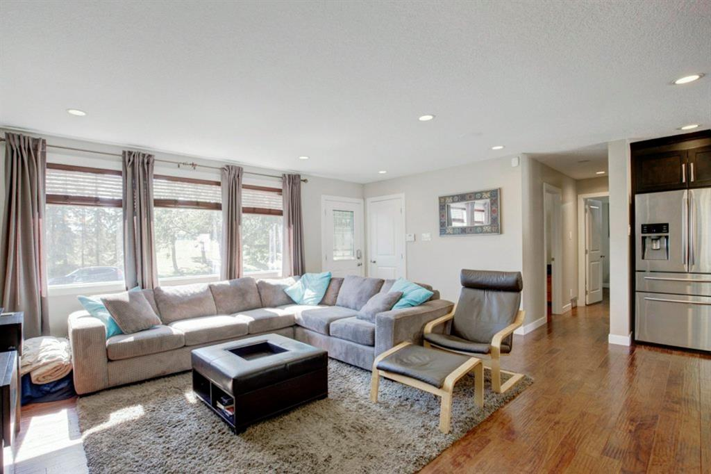 Come by our OPEN HOUSE this Sunday October 25 from 2-4PM. 2424 Langriville Drive SW in the highly sought after community of North Glenmore Park.  Sitting on a private, landscaped and fenced lot across from a green space with extra parking.  This bright and airy home has been fully renovated and opened up,  has great curb appeal and is in a very quiet location. Completely renovated in 2012, this ready to move into home. Warm hardwood floors throughout the main level. The bright living areas opens up to the spacious kitchen with granite counters and  NEW Stainless steel refrigerator (water/ice & double freezer), NEW Stainless stove and dishwasher as well!  With at total of 4 bedrooms. There are 2 good sized bedrooms upstairs, including the Master Bedroom with 3 piece ensuite and walk-in closet. And 2 more spacious bedrooms in the fully developed basement.  This home offers 3 bathrooms including a 3 piece ensuite with Shower, 4 piece main bathroom upstairs, and a 3 piece bath with walk-in shower down stairs . The fully finished basement  offers a huge Rec. Room with built in bar, spacious laundry and tons of storage.  Other upgrades include NEW High Efficiency Furnace, NEW HWT and NEW A/C!  The yard is fenced, landscaped and you can sit and enjoy your new hot tub!  Double, oversized detached garage,  Close to all levels of schools, public transit, shopping and more! Walk to Glenmore pool, Lakeview golf, sandy beach and only a 10 minute commute downtown. This home is worth a visit and is priced to sell. Shop and compare.