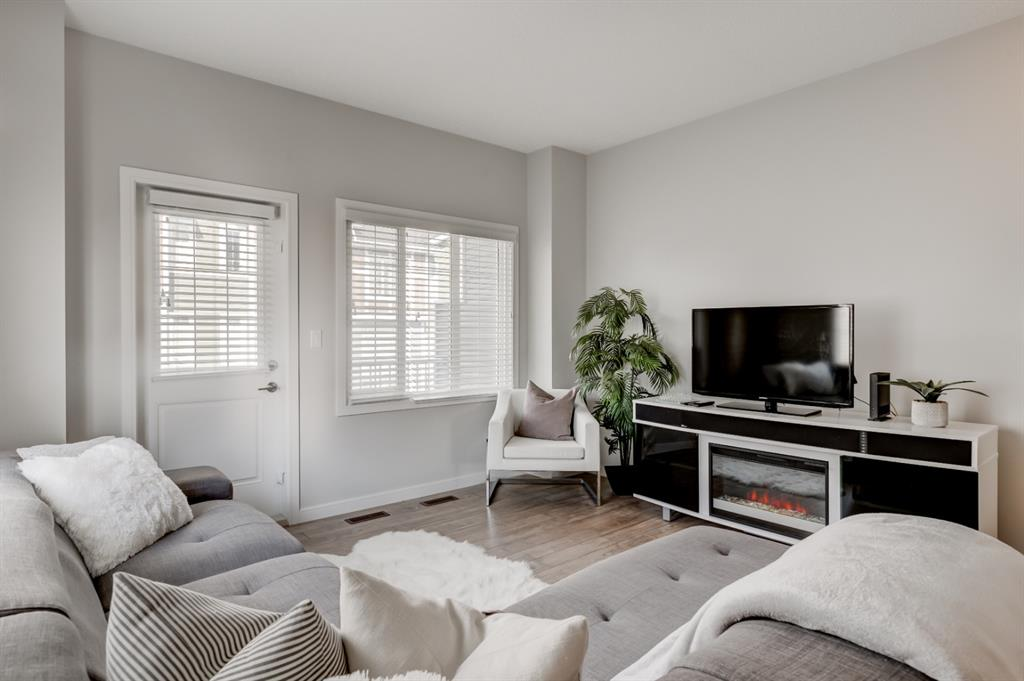 Located in the sought after NW community of Evanston, this quality Jayman built end unit is sure to impress! Enter the beautifully landscaped front yard to your main floor offering a flex room ideal for an additional family room, office space or gym, good storage space and access to your attached garage. The next level features 9 ft ceilings, numerous windows creating an abundance of natural light, upscale laminate flooring and designer finishing throughout. You will love hosting dinners in your huge kitchen with more counter space you ever dreamed of, ample cabinets and breakfast bar, offering the best in finishing with quartz counter tops and upgraded appliances. The upper level offers two master suites both with a full lavish ensuite with modern tile and quartz counters and the convenience of upper laundry complete this level! Other features include a private balcony with gas line for your BBQ, additional windows being an end unit, roughed in garburator and air conditioning for an easy install! Don?t miss out on this incredible opportunity to own your own home at such an affordable price!