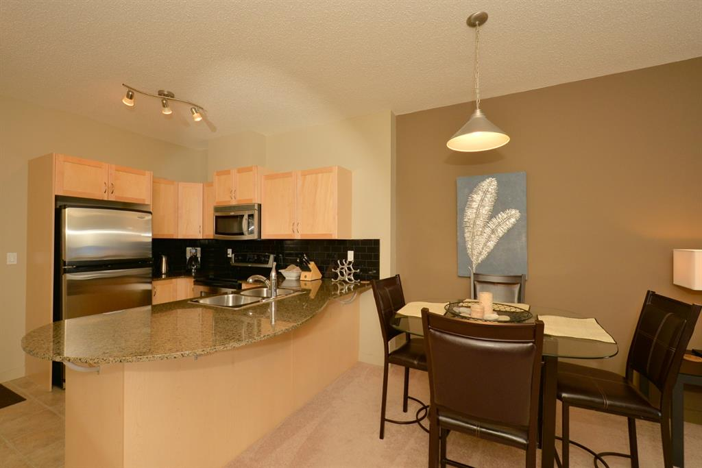 Welcome home! As you walk in you will find yourself next to the kitchen area. Next to the kitchen is the dining area and living room. This unit features two good size bedrooms with the master having a walk through closet. The unit also features a balcony and in-suite storage and laundry. The unit comes with titled storage and parking stall (both located in the parkade). The building is located by some major roadways including access to LRT. It's also located next to shops and is walking distance to parks and green spaces and also features a fitness room. To view this great unit please call your favorite agent!