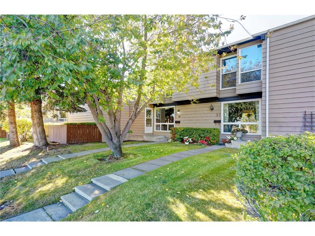 Wow! Almost 1500 Square feet of Developed Space with a Huge Rec Room in Developed Basement as Well as 3 Bedrooms and 2 Bathrooms on 2 Levels above. Big Fenced-in Back Yard backing onto shared Greenspace & Park. Front Yard with space for gardening and Proud Curb appeal. Private Parking in front with plug in. Steps to great public transit: 26 Mins to Downtown. Nearby Shopping and Groceries: Walkable Distance to Superstore and Thornhill Aquatic and Recreation Centre as Well as Schools of All Levels, Daycares and a short walk to the bike paths at Nose Hill Creek or Nose Hill Park. Hardwood Flooring in Dining Room, Kitchen and Mainfloor Bath. Big Bright Windows on all levels. Biggest Layout in Huntsview Village and Ideally located.