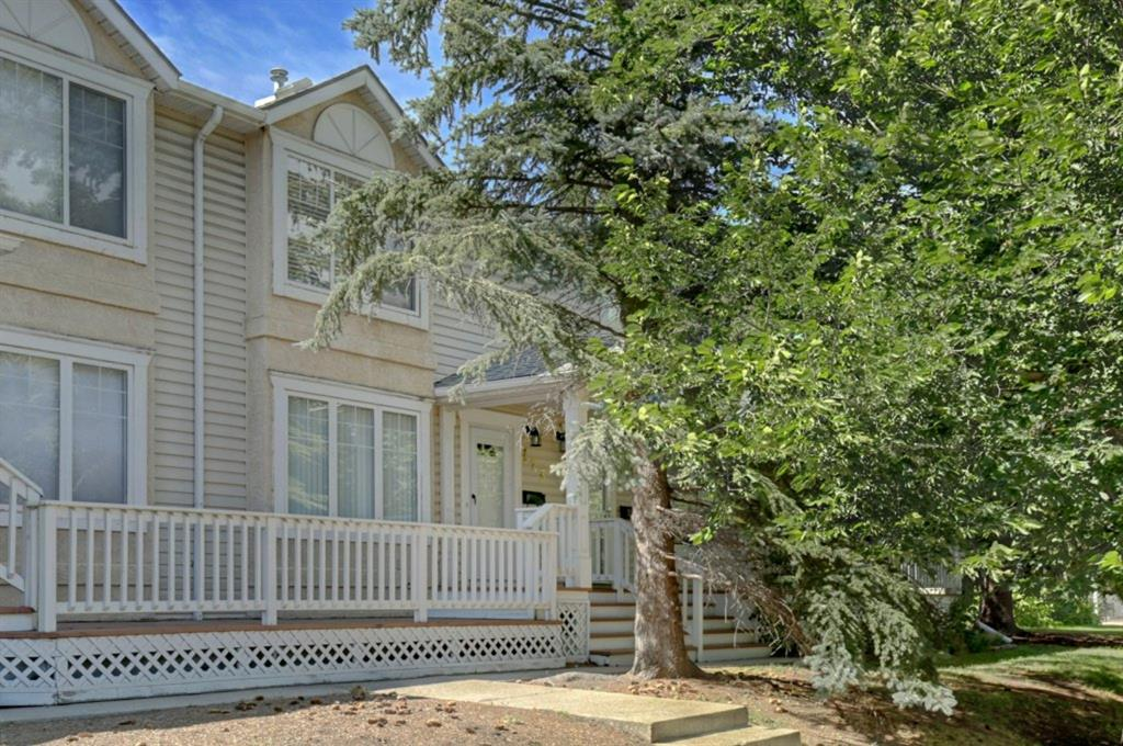 MUCH LOVED, BEAUTIFULLY KEPT TOWNHOUSE  WITH CRISP COLOUR PALETTE, GORGEOUS HARDWOOD, LOVELY STAIRCASE & BAY WINDOWS IN THE LIVING ROOM & MASTER.  Spacious decks at the front and rear are great additions to this home, offering the perfect spots to enjoy a morning coffee or to relax at the end of a long day. Other highlights include, a tastefully renovated bathroom, a high efficiency furnace (Dec 2015) & a new roof just 2 years ago. The kitchen & dining room are bright & sunny & give access to the rear deck via stylish french doors. Garbare, recycling & compost facilities are conveniently located in the newly repaved parking lot. There is one assigned parking spot, street parking at the front & extra stalls available for rent. This condo complex is quiet, clean, has large, safe, green space for children to play. good neighbours & is pet & family friendly. Plus with an excellent location, close to Westhills, Marda Loop, Garrison Woods & a quick commute to downtown, this is a great place to call home!