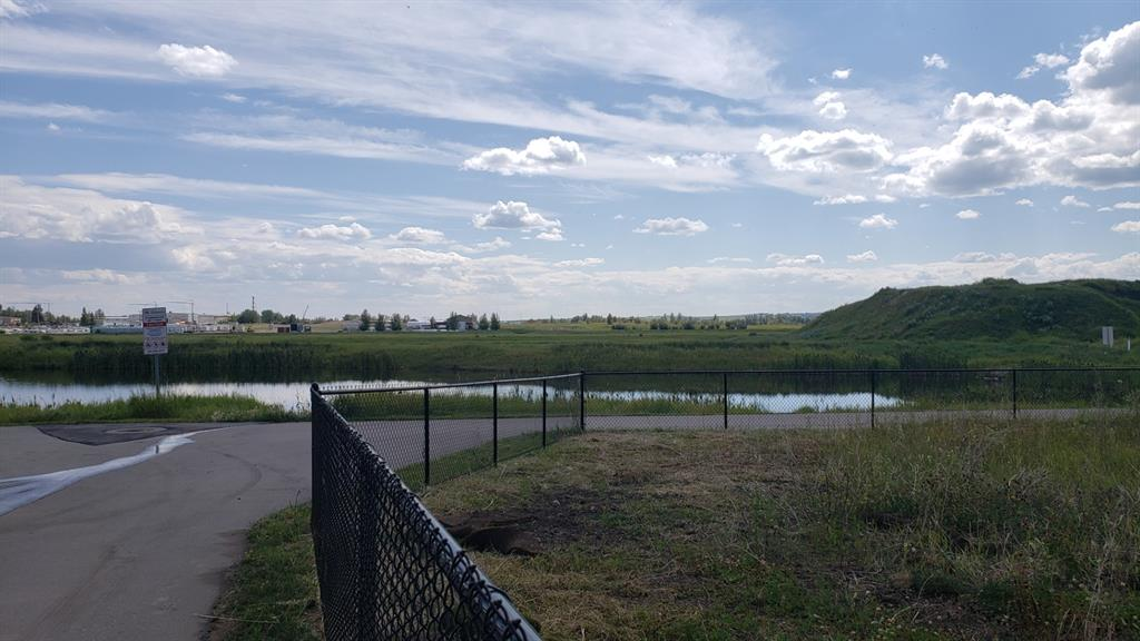 Backing onto a water feature this pie shaped lot is available to build your dream home on.  Located in a quiet cul de sac location in a premiere community in the town of Crossfield. Enjoy the friendliness of country living.  This property has great access to the Highway 2A for commuters.  A large south facing rear yard that overlooks the water feature.. not too many properties that provide privacy and a wonderful view.  Some mountain views possible from the rear upper floor of a two storey home.
