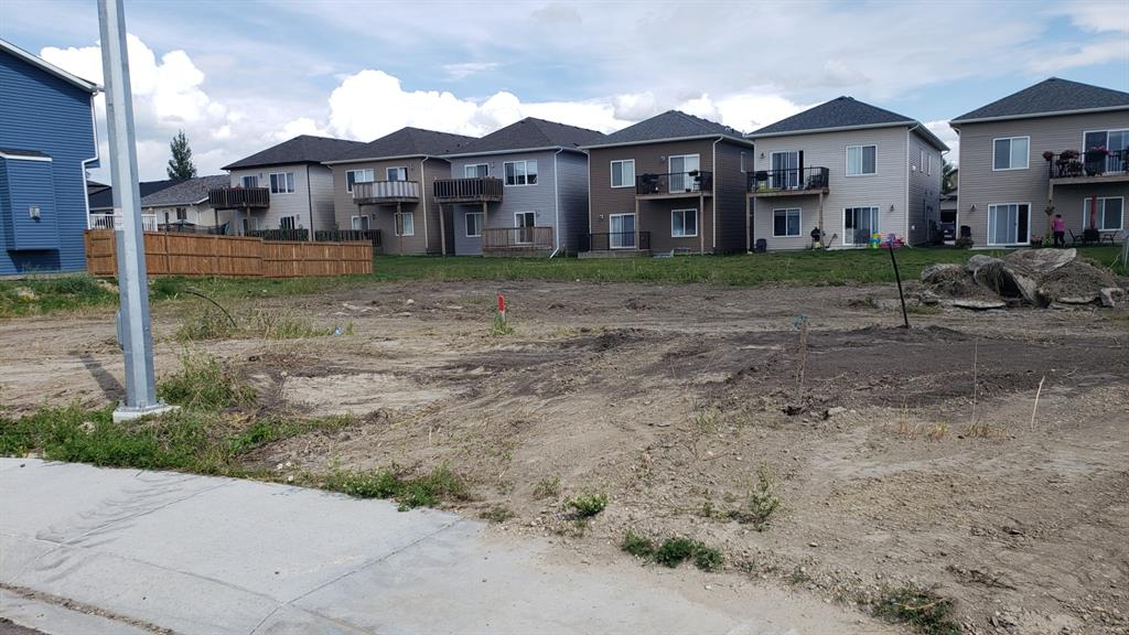 Fantastic large level building lot available immediately.  Come build your dream home. No immediate building commitment required. This fully serviced lot is located within a quiet cul de sac in a premium community in the town of Crossfield.  Crossfield is a short drive North of Calgary on the QEll highway; approximately 25 minutes from Calgary and 7 from Airdrie. Shopping and schools are available in this small town with larger shopping centers a short drive away.