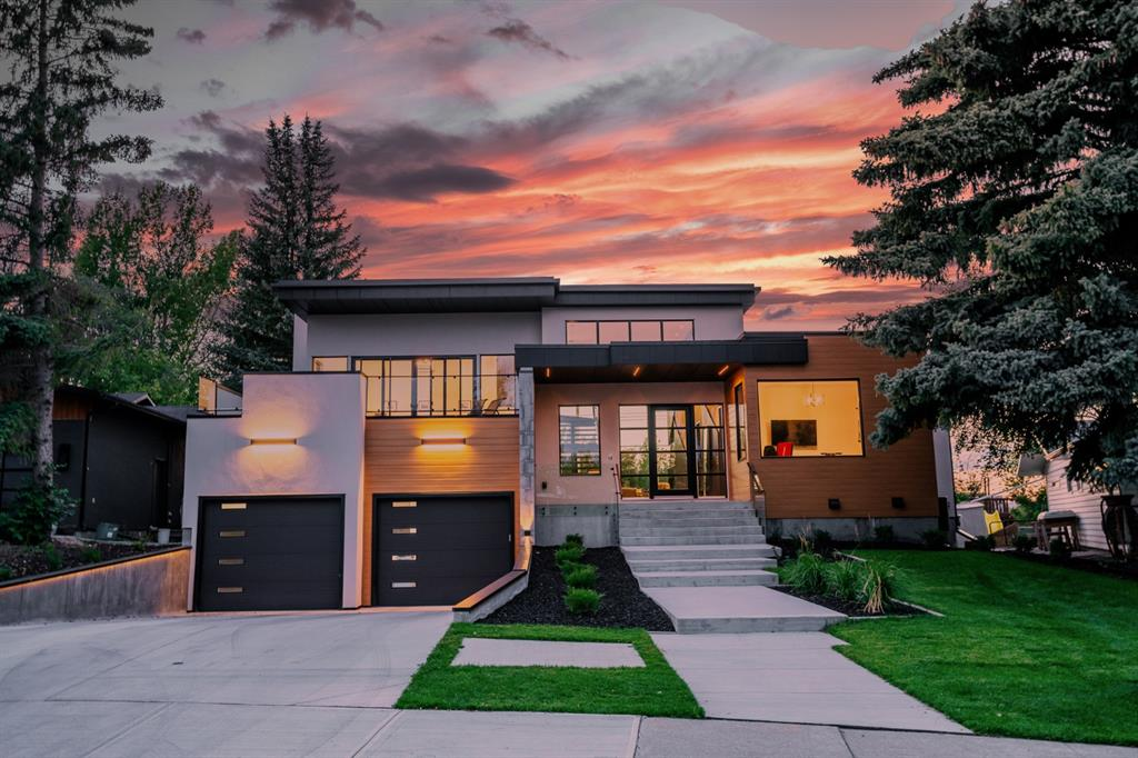 Be sure to watch the full 10 minute home tour of this stunning Westridge Fine Homes build!  If you've been looking for something unique in the Luxury home market in Calgary, we invite you to discover 2432 Sovereign Crescent SW.  The exquisite design is both bold, and elegant.  When you enter this modern build, you'll notice how the light pours through the two storey entrance and living areas from the front to the back of the home.  The soaring ceilings are accentuated by the striking feature wall design.  As you make your way to the back of the home you pass the stunning black marble fireplace, and catch a glimpse of the bow river valley through the living room windows.  Adjacent this space is the custom built, dark matte finished kitchen with black marble, and walnut accents. The kitchen design is spectacular, with integrated Miele appliances, and gorgeous under cabinet lighting and pendants.  The large walnut island with  seating for up to 6 provides a warmth to the space. There is even a private deck just for BBQ'ing.  The living room features a gorgeous marble fireplace, integrated storage cabinetry, and carries all the way up two stories.  The main floor Master Bedroom suite is equally special with a custom built headboard, pendants, and accent lighting.  The room steps out on to the rear deck.  The ensuite feels like a 5 star hotel that highlights fine finishes in its oversized walk-in shower, large dual vanity, wall panel design and freestanding tub.  There is also a walk-in closet with extensive walnut built-ins. Off the front entrance their is a flex space that can be used as a home office or home gym.  Take the open oak riser stair case with tempered glass rail brings up to the large bonus room space with sliding doors out on to the south facing stone tile deck - perfect for enjoying the sunshine.  2 more large bedrooms with built-in cabinetry, desk spaces, and ensuites complete the area.  Car enthusiast? The 3 car garage leaves plenty of room for your rid