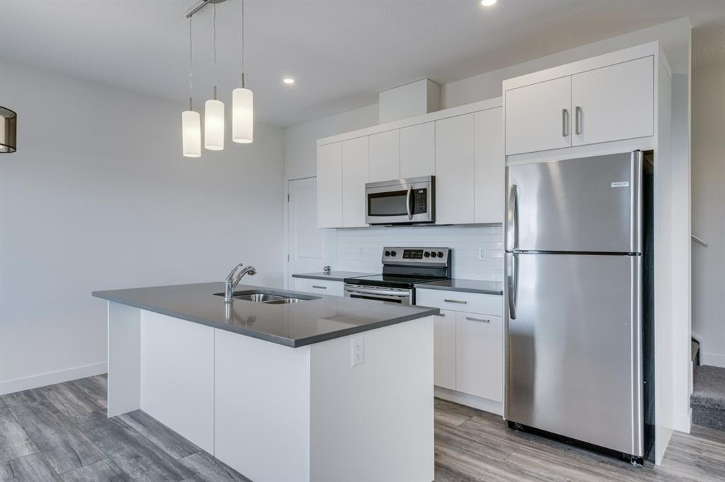 $239,900!!! UPGRADES are STANDARD at Slokker Homes! The Canal?s Townhomes are located just off 8th in central Airdrie. The Marcus A is a WONDERFUL CORNER unit with 1065 Builder's sqft.  It is a 2 bedroom home with a single car GARAGE (& full driveway), & a quick walk to the Canal's walking/bike paths & retail shops! The 9? main floor of this home is WIDE OPEN! The MODERN kitchen has SS appliances, SOFT-CLOSE doors & drawers, lots of QUARTZ counter space & a LARGE island where your can show off your culinary skills. Did we mention $243,900? The spacious family area is perfect to kick back, read a book or watch some Netflix. Upstairs you'll find TWO Master Bedrooms & TWO ENSUITES (both with QUARTZ counters), topped off with an upstairs laundry (laundry pair included). The basement is another 532 sqft empty pallet. Add another bedroom, bathroom & living space?...Home Theatre?...Gaming Room?* GET STARTED FOR JUST $239,900!!!  *Ask us for more details. **SHOW HOME HOURS 12-5 Sat, Sun, 4 - 8 pm Tue - Thur.
