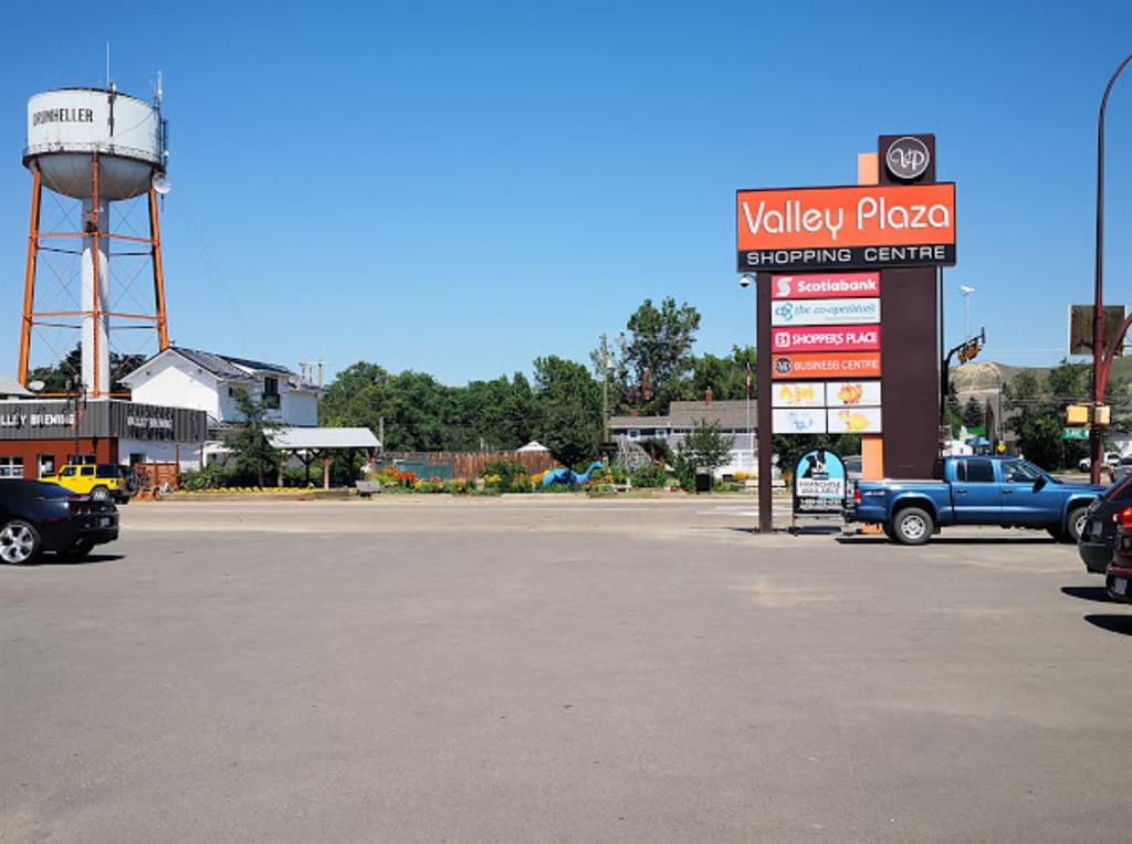 This vacant unit is located at Valley Plaza in the heart of downtown Drumheller with easy highway access. It is located west of High Way No.9 at the section of downtown Drumheller, with an average traffic flow of over 17,000 vehicles per day. Valley Plaza is Drumheller?s premier retail and business area with plenty of parking spaces.  Town hall, schools, provincial court house, library, fire station, RCMP, parks, Drumheller landmark/attractions, hospital, office and residential area are all in the surrounding area.  Valley Plaza also offers friendly and convenient shopping environment with exceptional services from their long term tenants such as Scotia Bank, SHOPPERS PLACE Department Store, Pizza Hut, The Co-Operator Insurance, Yavis Family Restaurant, PetValu, For Sight Vision Centre, MR. LIQUOR...Please call your agent for a private showing. Thank you!