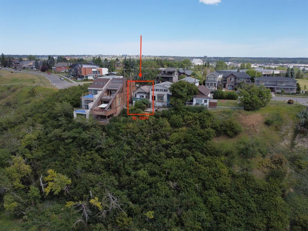 *ATTN: BUILDERS, DEVELOPERS OR ANYONE LOOKING TO BUILD A CUSTOM HOME* This premium 30-FT, R-C1 zoned lot on top of Scotsman?s Hill has one of the best views in the city & offers the apex of luxury for those looking to build a custom inner-city home. Poised on the prestigious ridge overlooking Stampede park w/ SPANNING Downtown/river/mountain views, this sale would include ALL PLANS & PERMITS & the seller will demolish the existing structure to prepare the land for redevelopment. DP is in the process of being approved & plans call for an architecturally stunning home w/ a commanding street presence & 3 rear balconies to capture the impressive views of Calgary?s downtown skyline. Located steps to the famous Scotman?s Hill & the off-leash dog park, this location on the ridge is home to only 4 other homes. Bring your own builder or build w/ C2 Development Group. Land here is hard to come by & this is a RARE opportunity in Ramsay. *VISIT MULTIMEDIA LINK FOR FULL DETAILS*