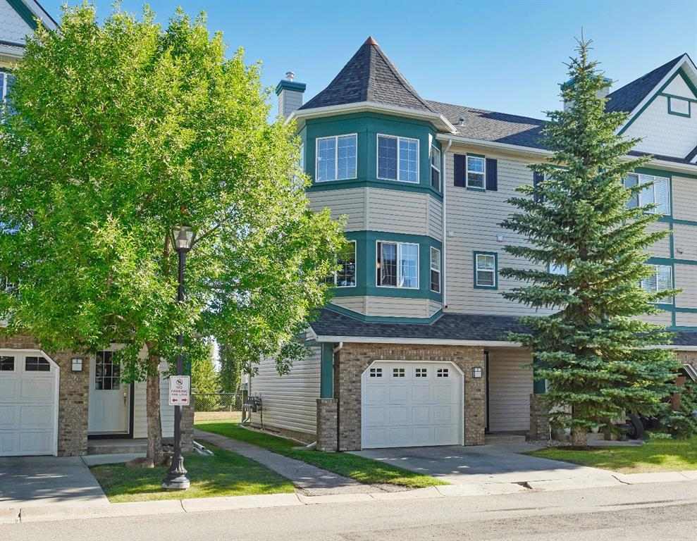 PRICE REDUCTION ALERT! Welcome to the Best Unit in Latitude complex. End unit backing on to wonderful walking paths with quick access to Calgary French International School, and Parks. The lovely entrance greets you in this magnificent townhouse. NEW CARPET. NEW PAINT. PRIDE OF OWNERSHIP! Large Living Room features a 12 foot ceiling, a built-in tile surrounded gas fireplace, and access to the Balcony. The balcony features a gas line to BBQ, and has a view on the walking path and  quiet green space.  The kitchen features stainless steel appliances, a new Bosch built-in dishwasher, and a convenient island. The bright dining room features lovely bay windows. The upper level features 2 master bedrooms with walk-in closets, 2 ensuites, and an open den area with a practical built-in desk. The fully developed lower level features a large recreational room. Close to amenities, schools, and walking paths. Easy Downtown access.