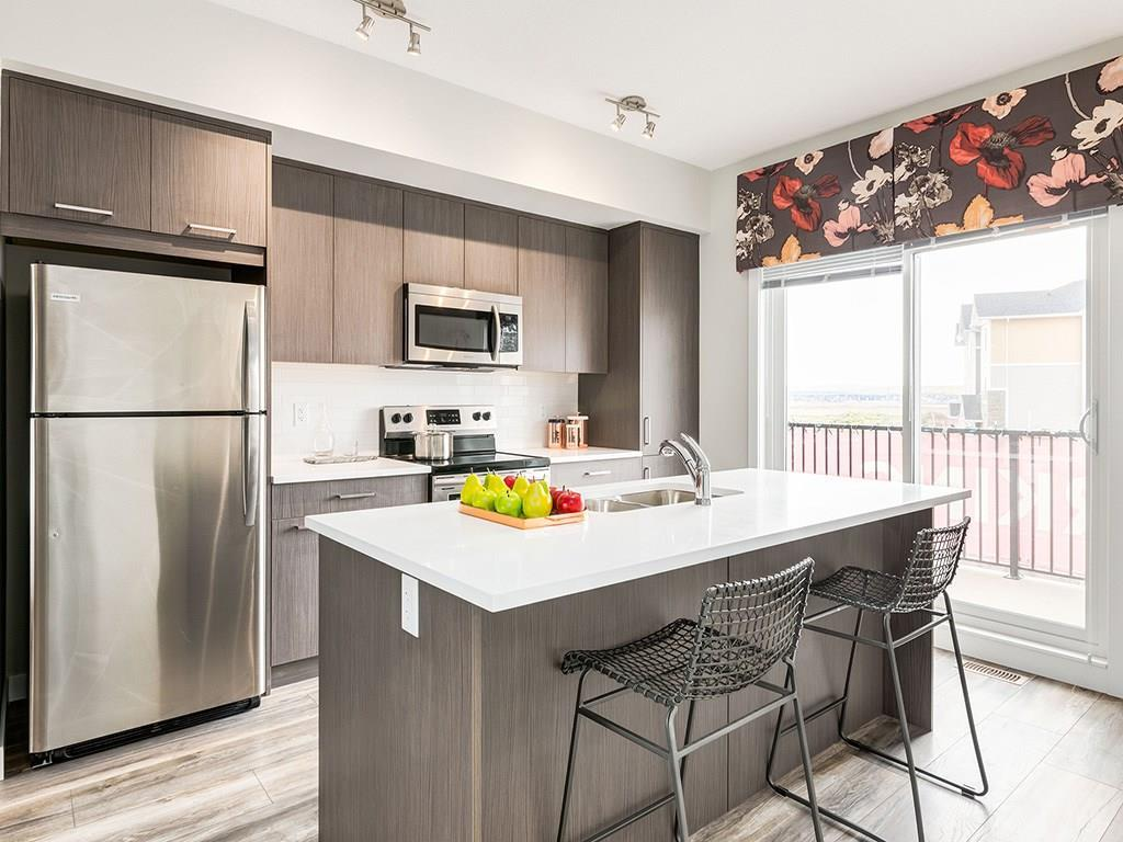 TOWNHOMES WITH GARAGES FROM $239,900!! UPGRADES are STANDARD at Slokker Homes! The Canals Townhomes are located in central Airdrie. The Heritage A is a 1215 Builder's sqft 2 bedroom home; & is a quick walk to the canal's walking/bike path & retail shops! The 9? main floor of this home is WIDE OPEN with lots of natural LIGHT! The MODERN kitchen has STAINLESS STEEL appliances, SOFT-CLOSE doors & drawers, QUARTZ counters, & HUGE ISLAND where your guests will gather to admire your culinary skills. A large dining area is great for entertaining or migrate to the 15' BALCONY & enjoy a warm summer evening. The spacious great room is perfect to kick back, read a book or watch some Netflix. Upstairs you will find 2 bedrooms & 2 full baths (both the ensuite & main bath feature QUARTZ COUNTERTOPS)! This home also has a den & half bath just off your ATTACHED GARAGE (complete with full driveway).*SHOW HOME HOURS 12-5 Sat, Sun, Holidays and 4-8 Tue-Thur. Pics are of an identical model so colours may still be selected if you act soon!