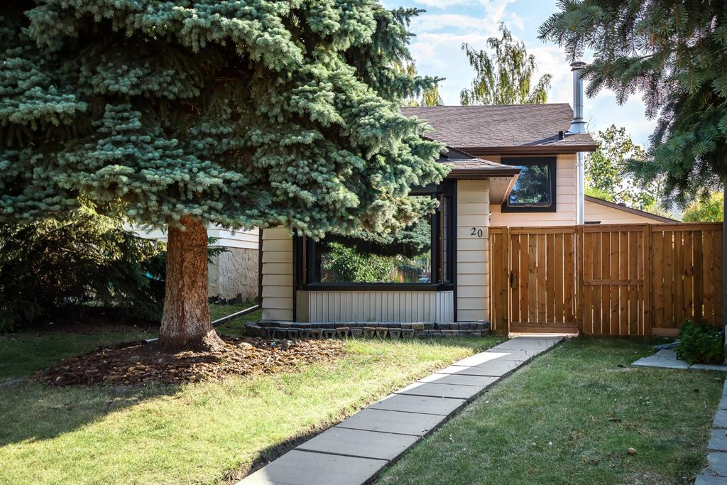 Location, location, location!!  Close to all amenities, schools, parks, mins to Deerfoot  Trail and only 15 mins to the downtown core. This 3 level split has been completely renovated from top to bottom. Beautiful Cherry hardwood floors throughout the main and upper level as well as the stairs. Ceramic tile in landing up and down as well as both bathrooms. The upper level features a stunning kitchen with custom hickory cabinets, newer stainless steel appliances, quartz countertops, window above the sink, 2 pull out pantries, built-in oven and microwave. Nook area off the kitchen is a great size for a dining table. Door off the kitchen nook to the east-facing back yard. Spacious master bedroom with double closets and double doors with organizers in all closets. The second bedroom up features a murphy bed as well as ample closet space. 4 pce bath up.  4 steps down to the living room with high ceilings and large windows facing the front of the home. Another door to the yard off the living room area. Another 4 steps down to a beautiful 3rd level that has a custom wet bar, stand-up freezer, laundry area and custom cabinets for extra storage. Ceramic tile down with heated flooring. Wood burning fireplace down. Large windows down for plenty of light. Another 3 pce bath down with heated floors. Tons of storage under the main level crawl space. The property is fully fenced and landscaped with an oversized heated garage that is fully insulated and drywalled. This is a dream garage with shelving and workbench. Newer furnace and hot water tank as well as a water softener. Newer shingles.  Poured concrete on the side of the house for an extra entertaining area. This home has been well over $80k of upgrades in the last 5 years and has been extremely well maintained and looks like a showhome. A must to see!!