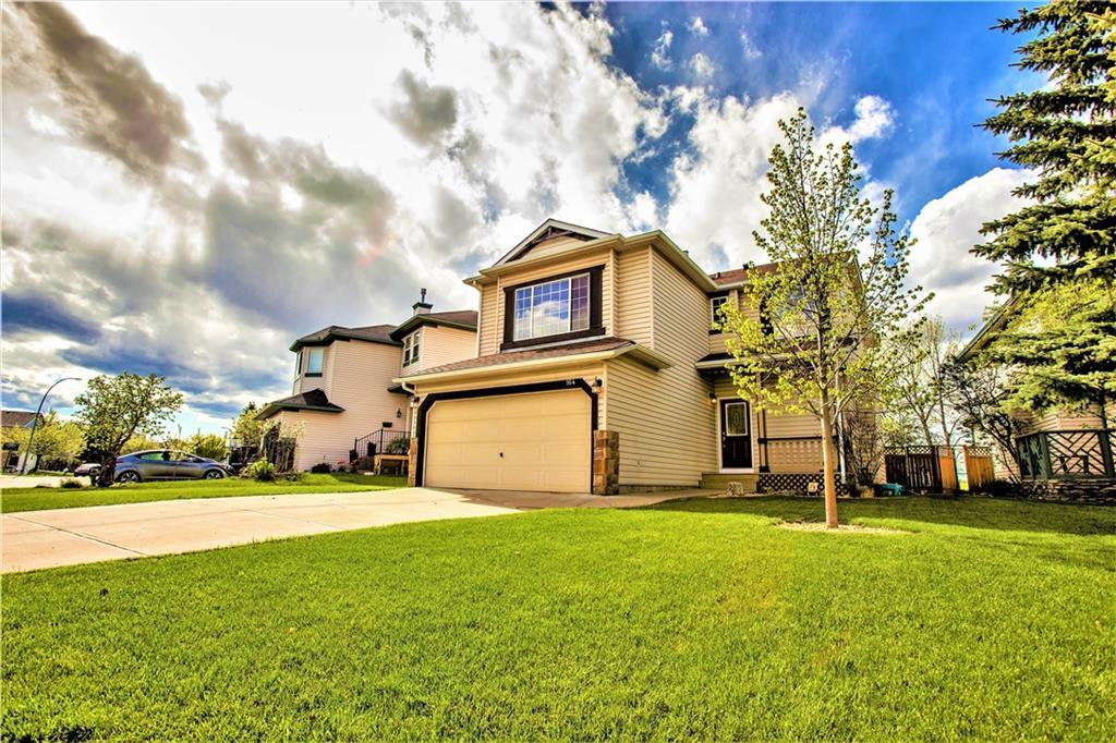 Welcome Home! Terrific home in the outstanding lake community of Lake Chaparral with over 2600 sq ft of living space. Only 3 blocks from the lake, this 3 bedroom home backing onto green space boasts stunning hardwood floors throughout, recently upgraded kitchen complete with stainless steel appliances, and granite counter tops. A formal dining room, powder room, main floor laundry and a large living room round out the main floor.  Upstairs showcases a Spacious bonus room with vaulted ceilings, and a corner fireplace,  bedroom , and a Spectacular owner?s suite complete with stunning spa like ensuite as well as his and hers walk in closets. Fully finished basement with bedroom, bathroom and recreational area.  All New carpets in this home.  New roof in 2018. Call today for your private viewing. Shows 10/10!