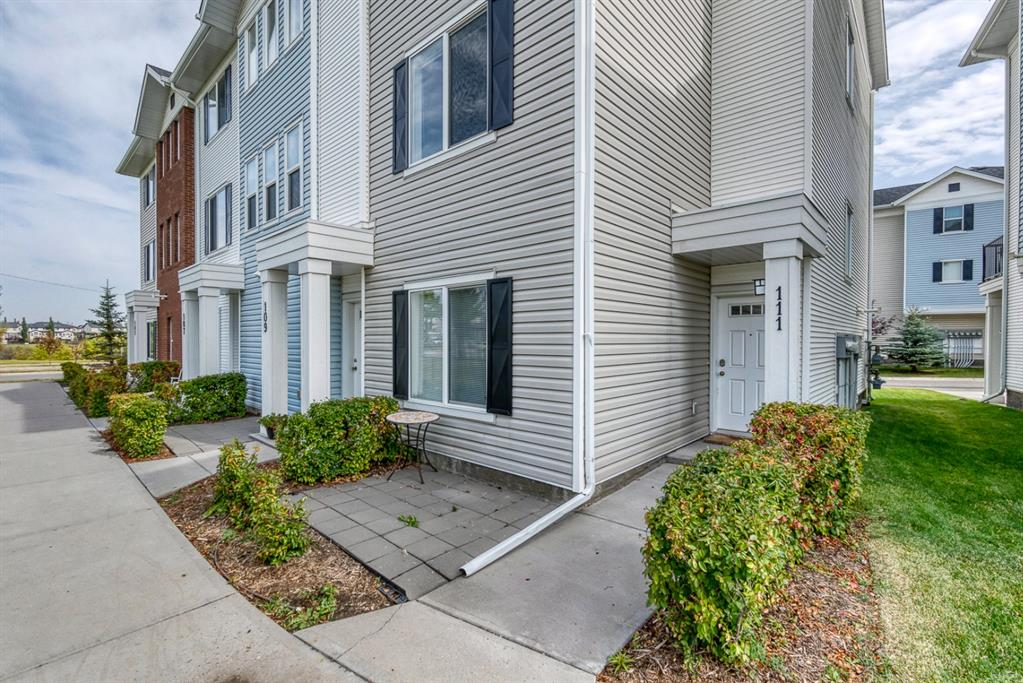 Welcome to this large three storey end unit townhome in the heart of Silverado;  walking distance to shopping, public transportation and numerous parks. Not only does this unit face west; it overlooks a beautiful green space, with a walking path and a large pond located directly across the street. This freshly painted home  has an open concept floor plan offering an abundance of natural light coupled with 9' ceilings, large centre island, granite countertops, and a gas fireplace. The upper level adds the total of two generous sized bedrooms in addition to the  bonus room; one four pc bathroom and the master bedroom with an additional four pc ensuite including a walk in closet. The lower level  allows you to use this space as a gym or a third bedroom, including an additional 4 pc bathroom. The attached garage is oversized with plenty additional storage space.