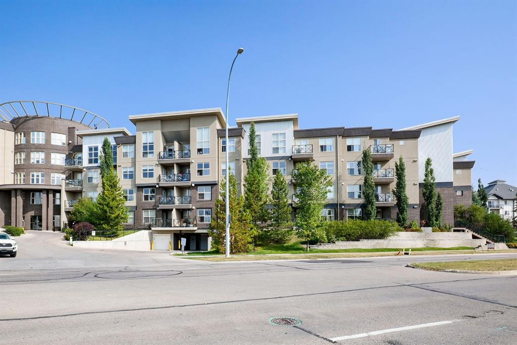 Lovely 2 bedroom & 2 bathroom corner unit in desirable�Arbour Lake!� Bright & open floor plan with a northeast facing balcony! Terrific location,�just steps from lake access, restaurants, shopping & LRT! QUICK access to Crowchild Trail, West Stoney Trail and so much more. Beautiful City views from your balcony!! The unit is flooded with natural light due to its exposure!�This is a very functional plan with a large open concept living room�and dining area.�Chefs kitchen with Granite counter tops and stainless steel appliances with a gorgeous 16 ft vault! TWO full bathrooms - a fireplace & in suite laundry! This is a move-in ready unit and also comes with 2 assigned underground parking stalls. Maintenance-free living awaits in this luxurious corner unit.�Take the elevator directly to your door & immediately be impressed by the 9? ceilings, in-floor heat & plethora of natural light. The master is a relaxing retreat with a walk through closet & ensuite with a soaker tub and separate shower. 2nd bedroom & an additional full bath completes the unit! Arbour Lake offers endless amenities including access to the wonderful Lake but if you would prefer to not go out, the building itself has a wonderful common room & a work out area!�Pride of ownership is shown throughout. Exceptional value.