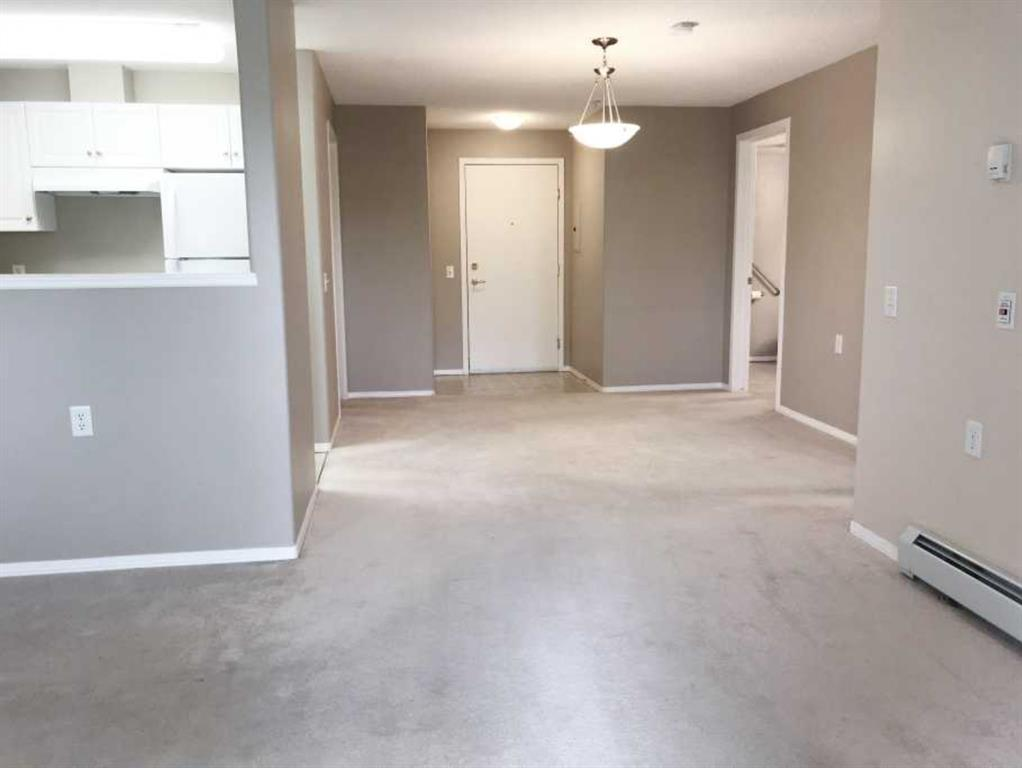 """*******  Be in by Christmas ******  This is the lowest priced unit available today in this complex and Somerset.  Come visit this sparkling clean, 3rd floor condo in Legacy Estates Somerset, a 55+ Adult living Complex in the SW.  Professionally cleaned ( including the window blinds) in """"move in"""" condition. Unit 332 is a comfortable, 1 bedroom with a convenient den for storage, crafts, computer room or extra bedroom space. A bright, well cared for """"galley style"""" kitchen with a brand new dishwasher, clean oven and refrigerator.  Your laundry area is conveniently location in this large 4 pc bathroom. Plenty of space for a hutch and dining room table. This condo size is ideal for a single person but many, many couples in this complex live comfortably in this floor plan as well..  Your covered balcony faces NW with lovely """"park like"""" treed views.  Amenities in Legacy Somerset make ownership here a great choice.  You have luxuries like formal Dining by a Red Seal chef, 5 evenings per week.  Enjoy morning coffee, light breakfast and lunches at the Bistro area.  Join the billiard,  shuffleboard  and card playing leagues. Stay fit in the exercise area. Manicures, pedicures are offered in the """"in house"""" hair salon.  Enjoy a good book in the well stocked library or entertain guests in the media room.  A visitor in town?  Guest suite is available for rent. Meet the gang at the Friday pub hour or on Wine Wednesdays.  Soo much to offer and the bonus is that your low condo fees include HEAT, ELECTRICITY.  (  approx  $100 of these condo fees pays utilities each month. That's dirt cheap )   The size of this unit has worked for couples and single owners alike."""