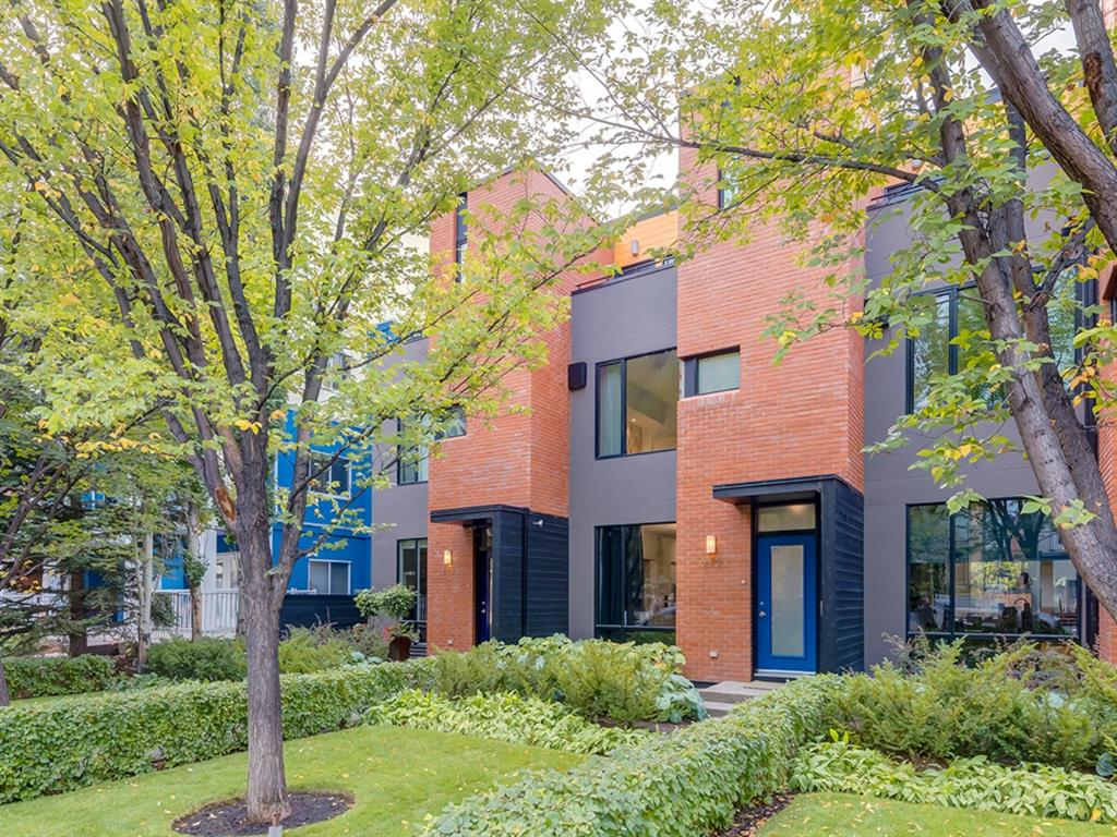 Nestled in a charming neighbourhood full of culture, this stunning contemporary 3-Storey townhouse boasts over 3000 sq ft of stylish living space. The quiet street & beautifully landscaped front yard make for a warm welcome. This dwelling features a bright wide-open chic main floor living room, striking kitchen with island, Miele appliances including 5-burner gas cooktop, Sub Zero fridge & wine bar with wine fridge. Notable rooms include a spacious dining room, a bold sun-filled family room supplying effortless entertaining space with two storey vault, & a second-floor den area with built-in desk overlooking the vault. Solid hardwood floors span the main floor & staircase to the second floor that furnishes a laundry room plus a generous bedroom with walk-in closet & 5-piece ensuite. The top floor is the dedicated primary suite offering skyline views from private patios off the front & back. His & her sinks, a unique steam shower & one-of-a-kind boutique-like closet showcase this bedroom. An additional bedroom, full bath plus spacious family room furnish the fully developed basement. The private South courtyard garden with pear trees offers a wood/gas fireplace, built-in gas grill with dual burners & griddle. Additional amenities include a double garage with finished walls & new epoxy floor, air conditioning, stylized lighting, built-in speakers & in-floor heat. Close to quaint coffee shops, diverse cuisines, local boutiques & trendy salons along with your choice of wellness & fitness studios. Indulge in the mix of urban treasures & eclectic canvases that surround this modern-chic abode.
