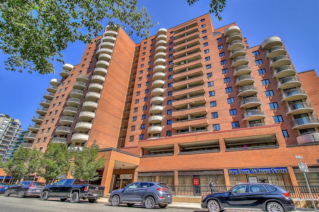 Attractive bright and spacious 17th floor south facing condominium in desirable Prince?s Crossing, steps from the Bow River and the expansive pathway system and in the heart of the Eau Claire district. This 1216 square foot 2 bedroom and den residence features a spacious South facing balcony that is perfect for entertaining and for your BBQ, Enjoy the air conditioning system while you survey your upgraded wood flooring in the living, dining room and hallway, ceramic tile flooring in bath, kitchen and the front entry. Newer corian countertops, backsplash in kitchen, and stainless appliances plus an electric fireplace are just a few of the upgrades in this unit. The storage area has ample space to add in-suite laundry with Board approval. This unit features spectacular views of the downtown skyline, the river valley and West to the Shaganappi Golf Course. Building amenities include a recently upgraded Fitness room and Sauna, common laundry facilities and bicycle storage. Evening concierge services provides great security. The Common areas of building were also recently upgraded, one Heated underground assigned parking space A-16 is conveniently located on the first level. Additional storage available on the second level through the Condo Corp at a very low monthly fee.