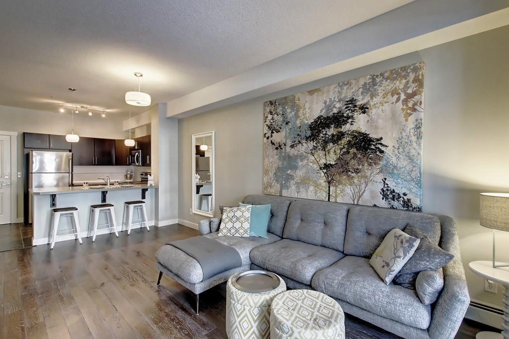 WELCOME HOME!!!.....This gorgeous one bedroom with contemporary finishes is waiting for you!!  High ceilings, stainless steel appliances, spacious rooms, IN-SUITE LAUNDRY and separate assigned STORAGE LOCKER.  This home also welcomes your pets....That's right..PET FRIENDLY!!  This location in one of Calgary's premier communities offers all of the amenities that you need/want.  Parks, paths, transit, shopping, exercise, schools, restaurants and SO MUCH MORE!!  This home is ready for you to move in......Don't miss out on this gem!!!